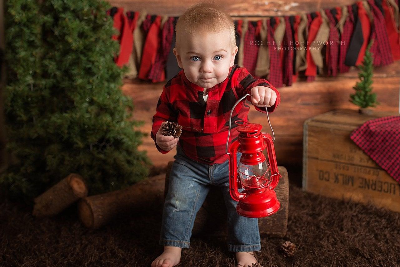 lumberjack boy with red lantern