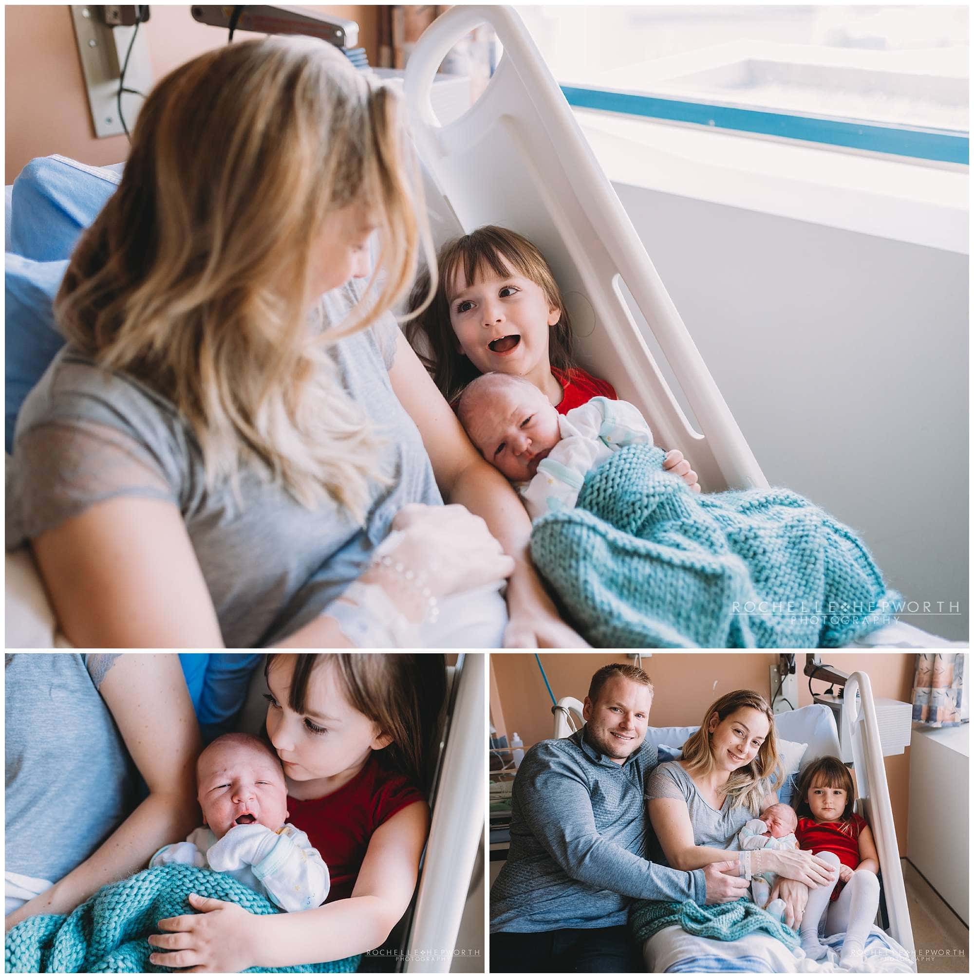 sister cuddling new baby brother next to mom in hospital bed