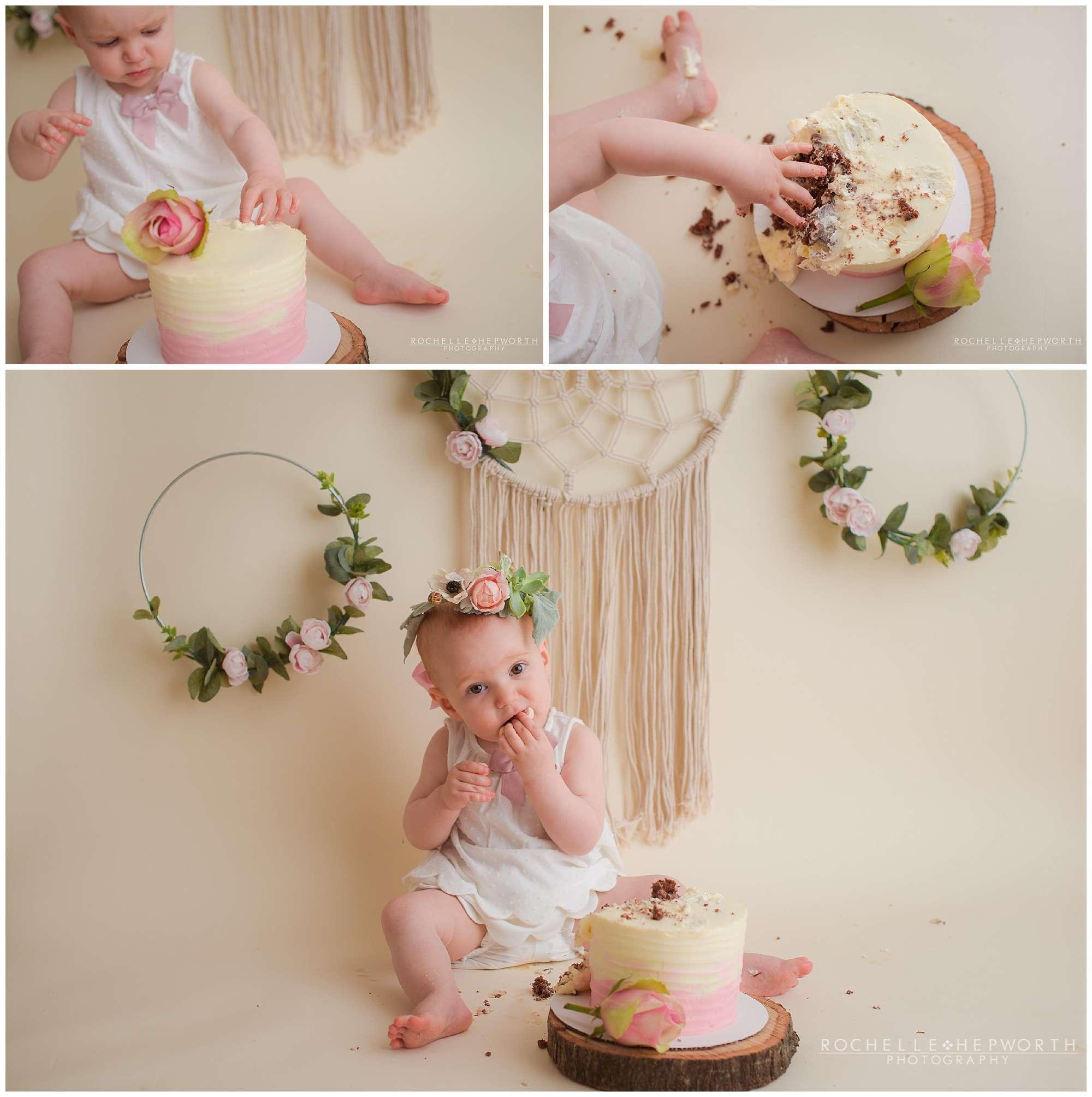 toddler girl eating cake during boho cake smash