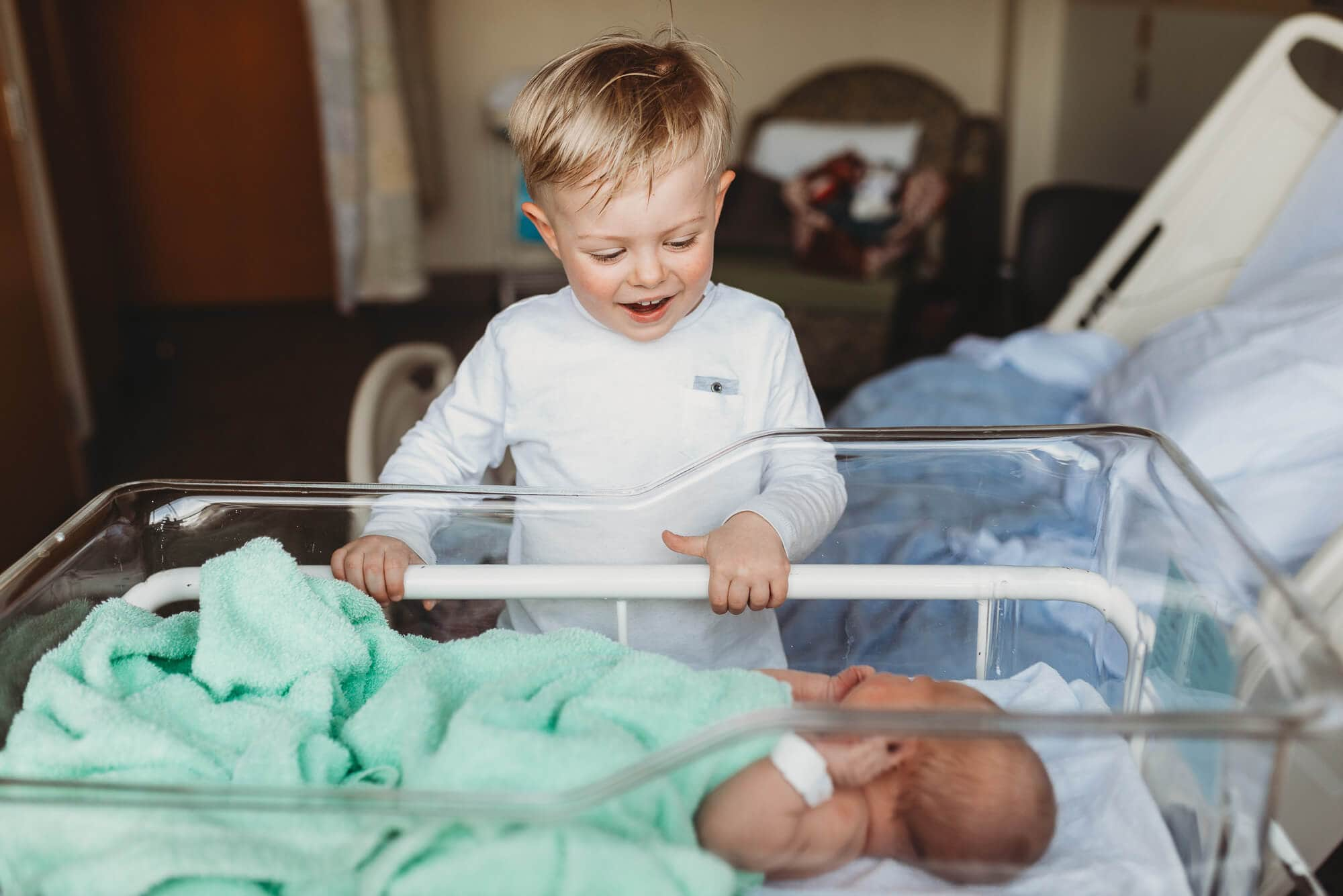 big brother meeting newborn at Lions Gate Hospital