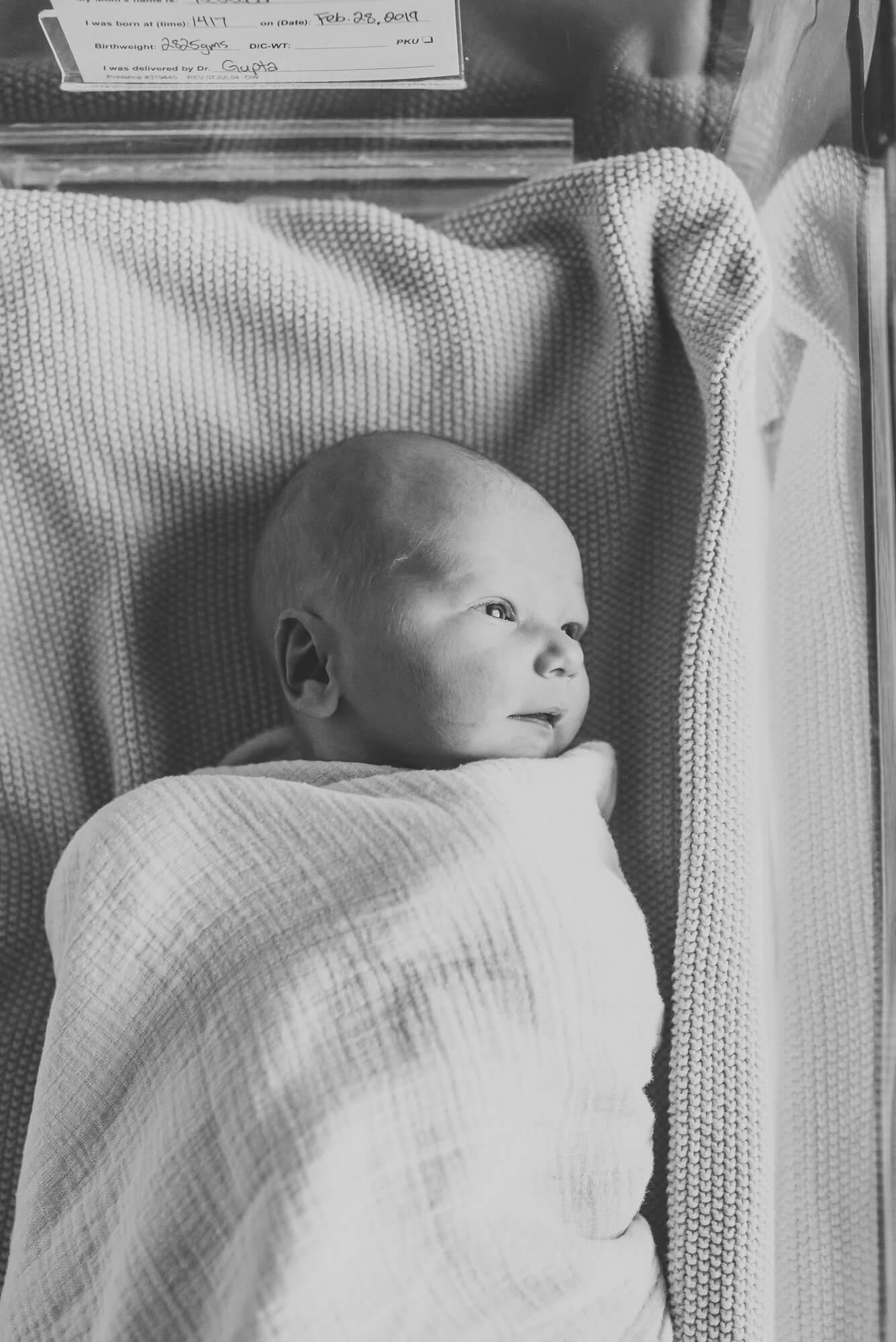 newborn looking wistful