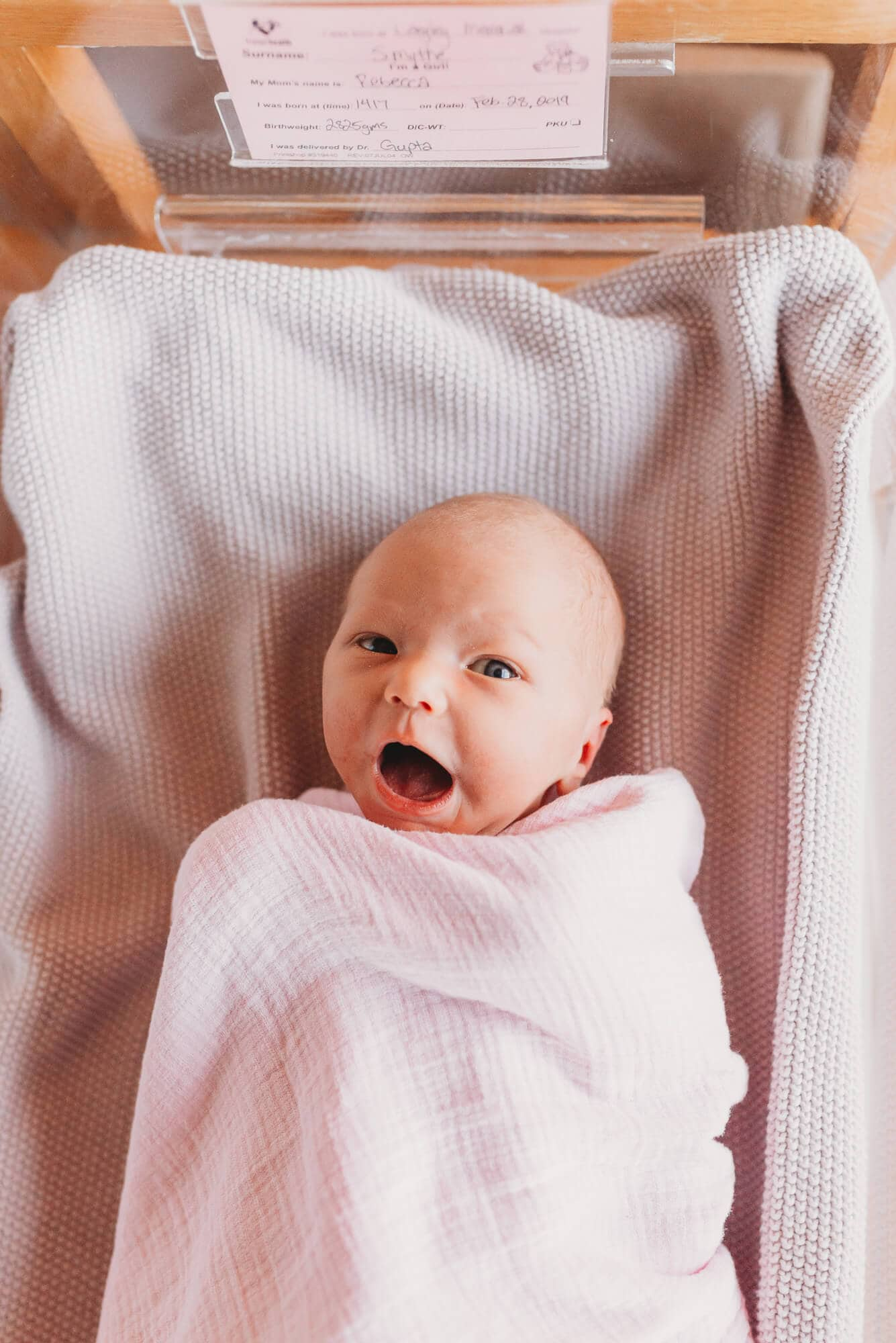 newborn with surprised look