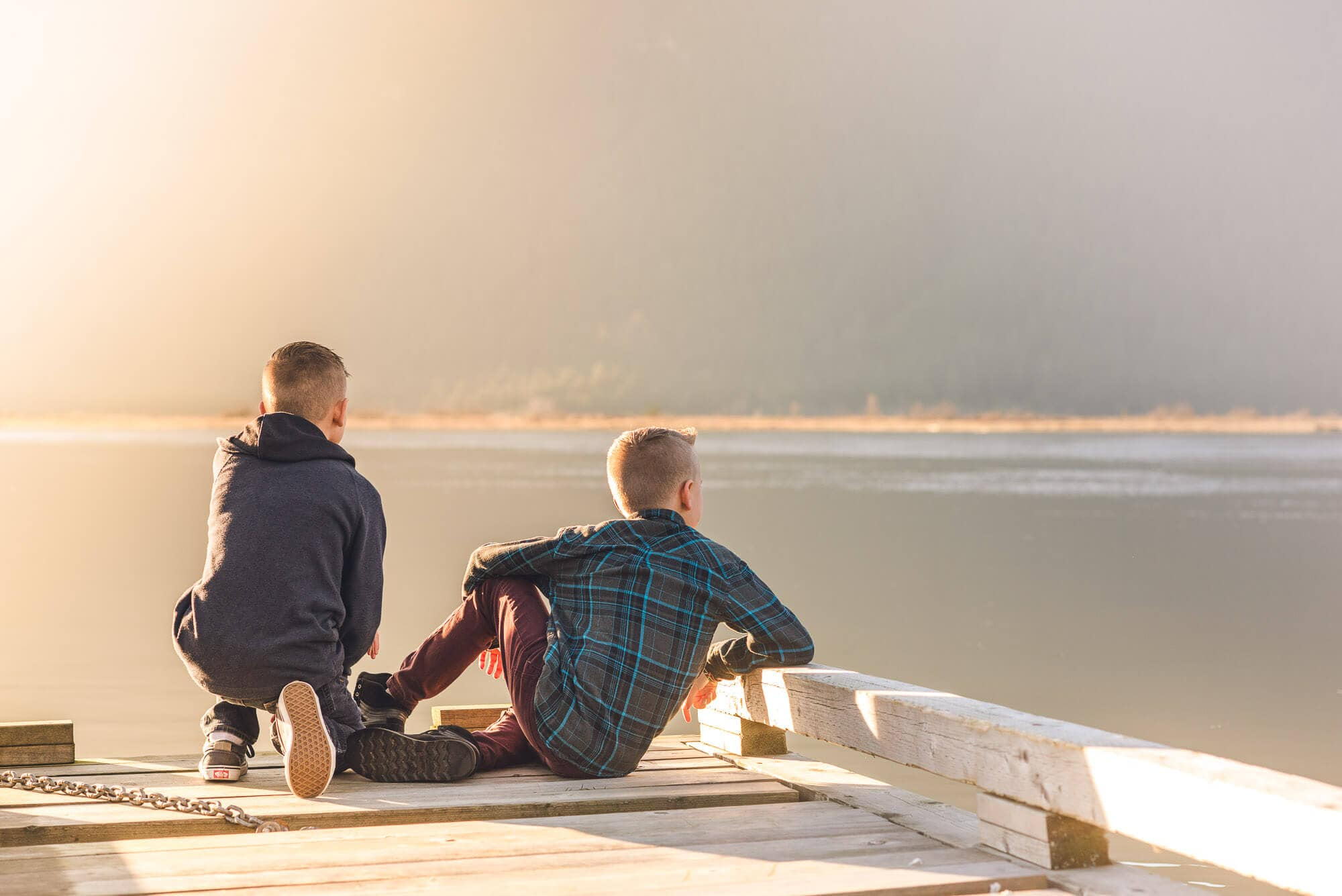 Pitt Lake dock with two brothers during family photography session