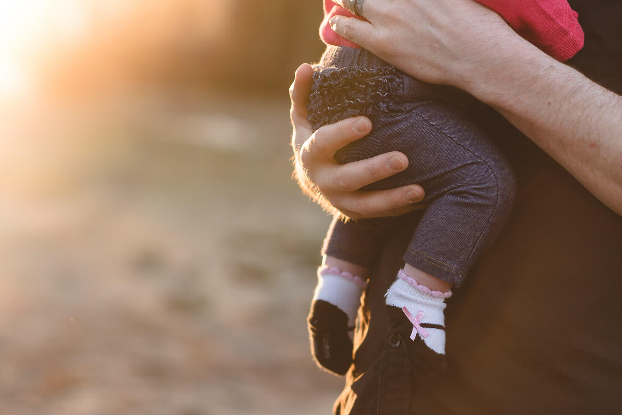 Port Moody BC dad holds baby daughter in golden hour photography session
