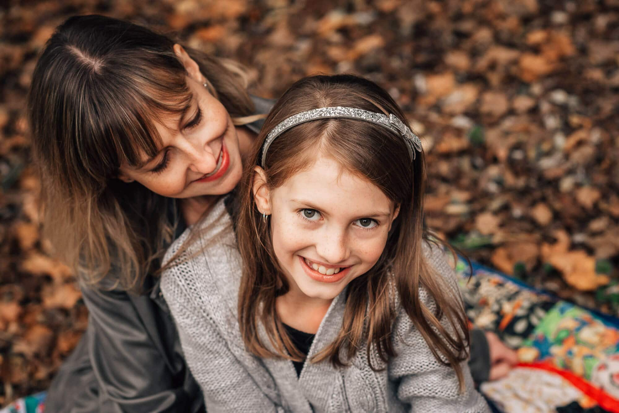 mom and daughter pose in family photography session in Deer Lake Burnaby