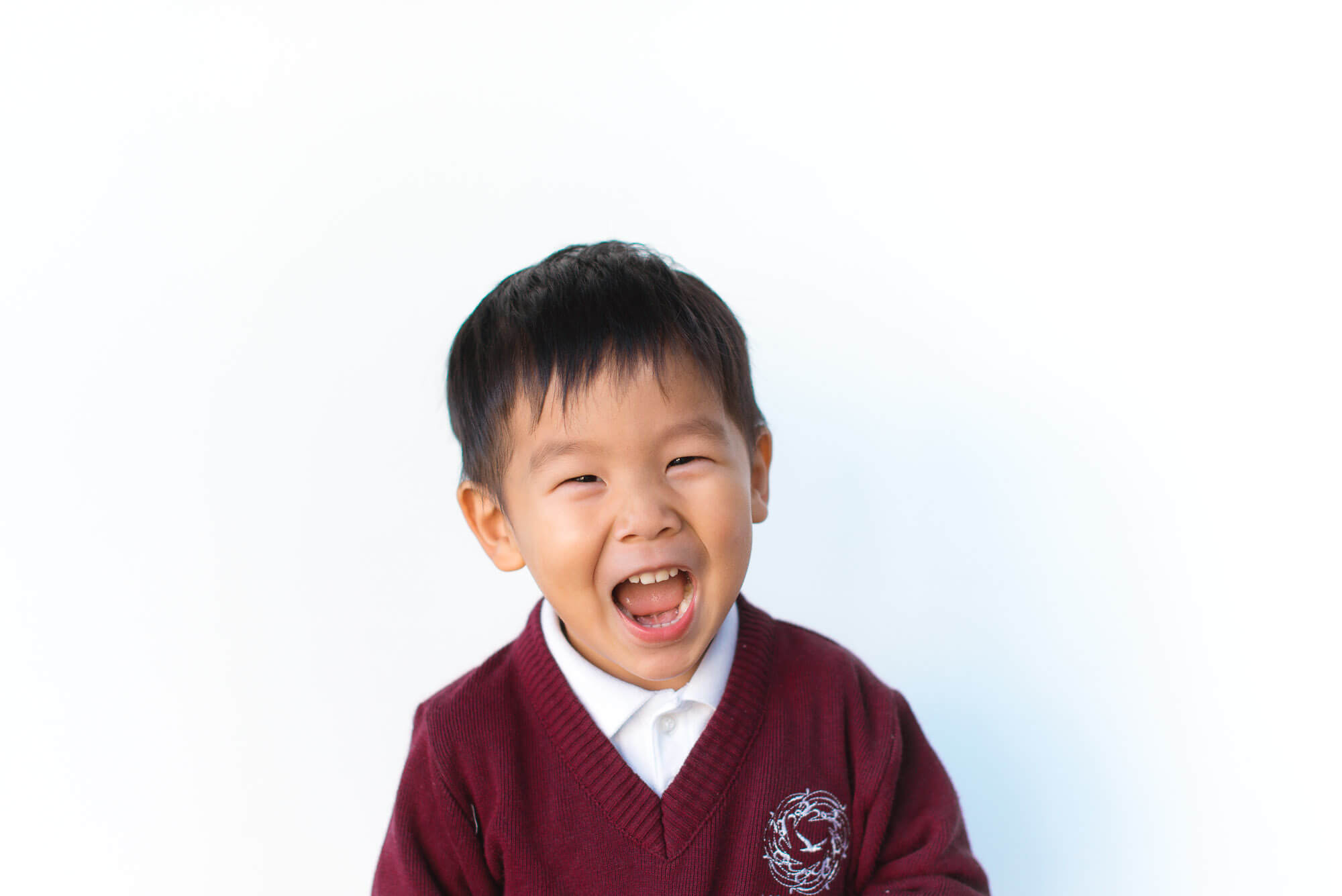 boutique school photography happy asian boy with huge smile