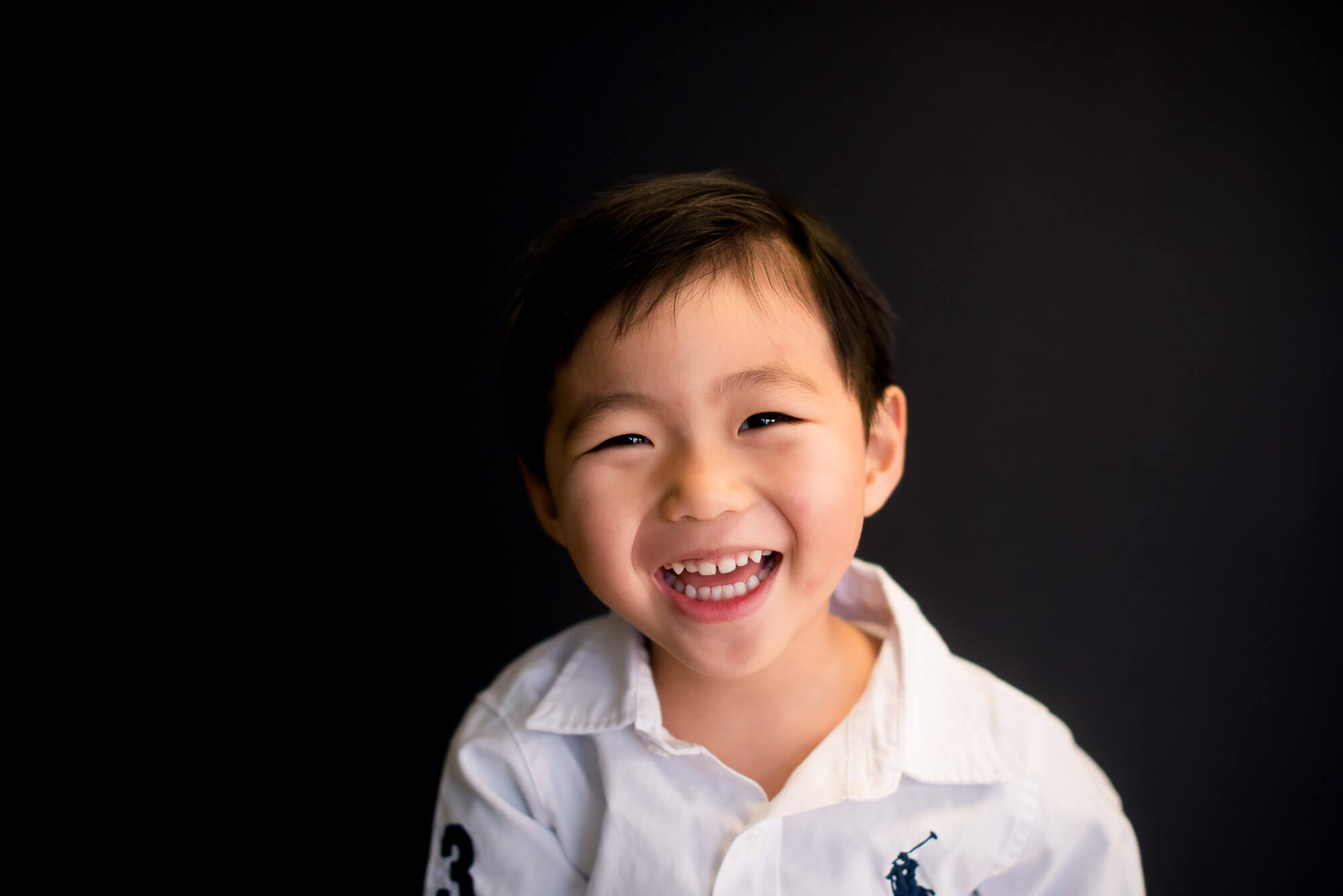 laughing boy in modern and timeless school photography