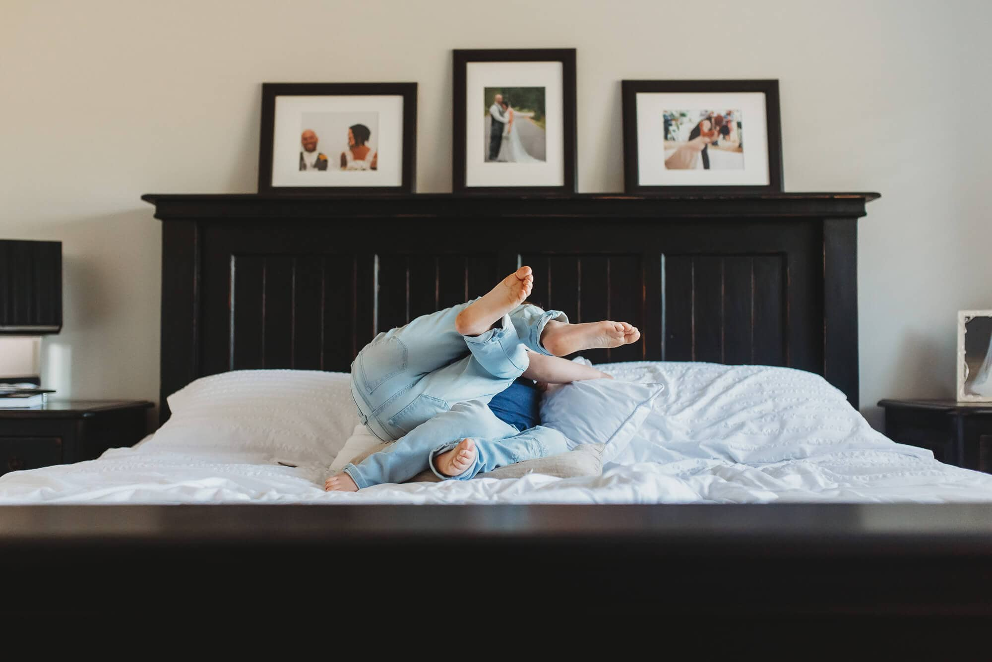 boys tumble on bed Vancouver Family Photographer