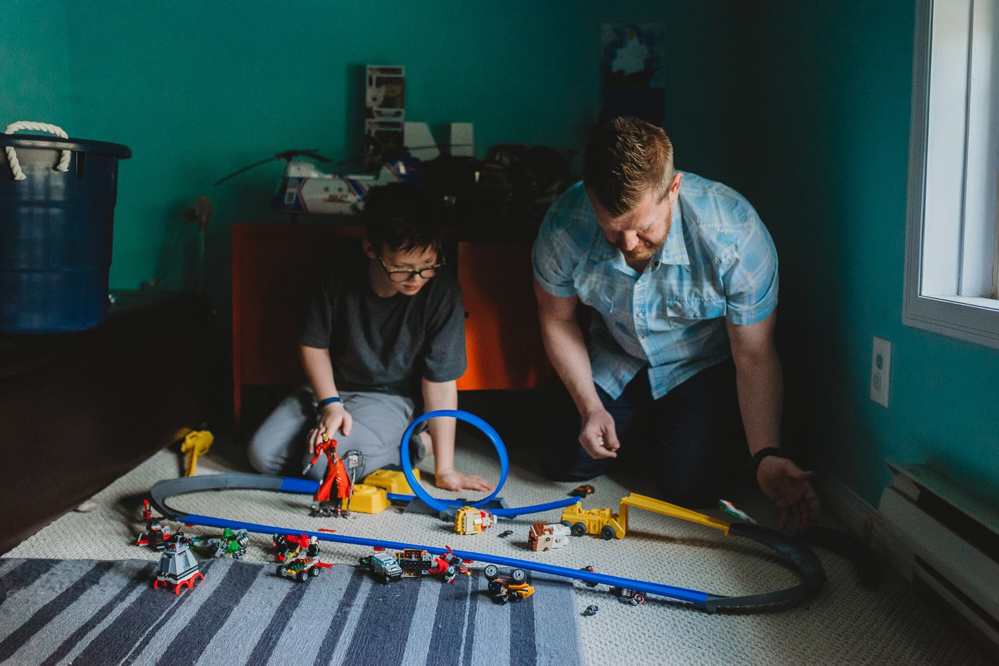 dad and son playing with cars