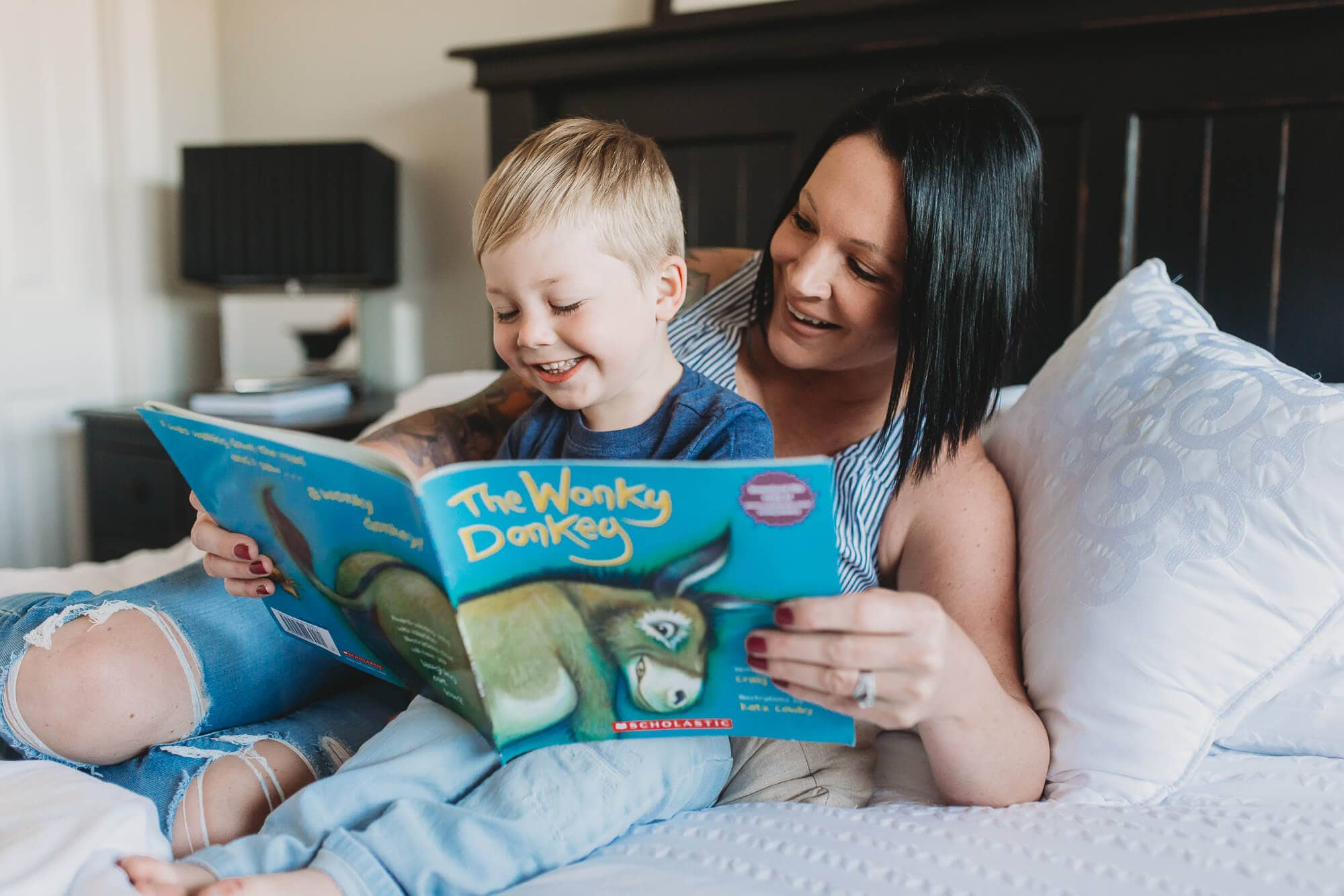 Vancouver Family Photographer shows mom and toddler reading book during Vancouver family photo session