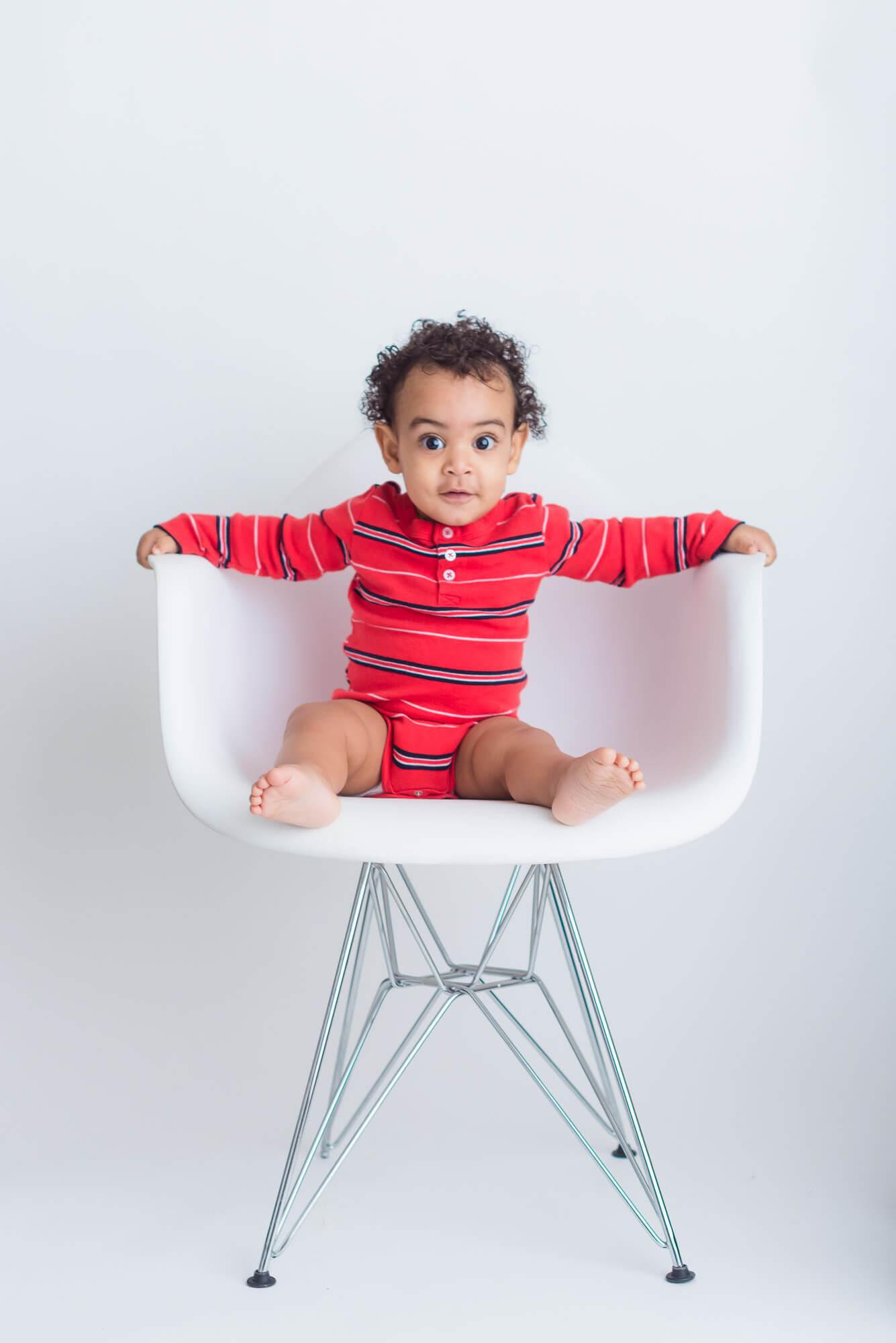 studio child portrait of boy in eames chair