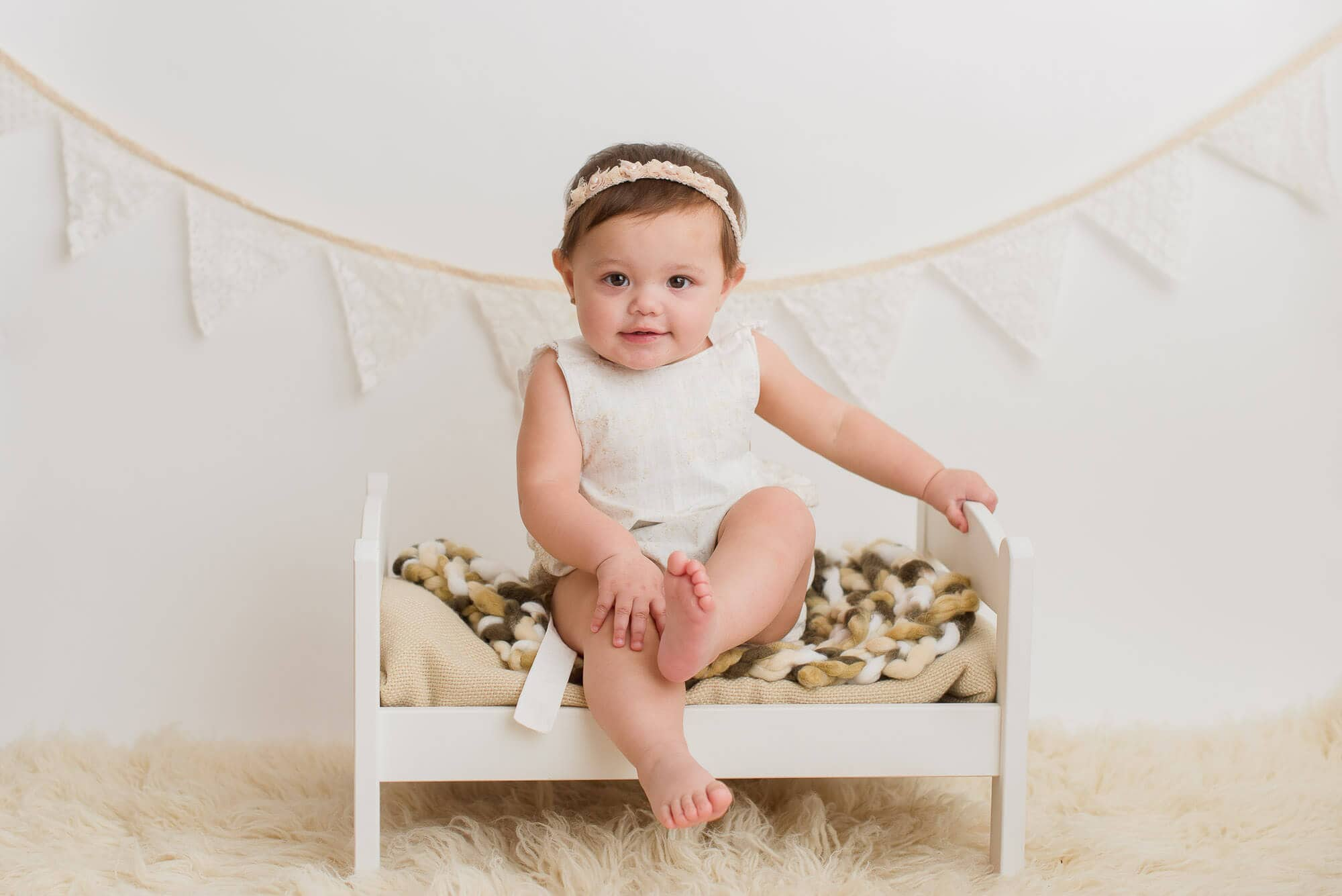 milestone session with girl sitting on doll bed in Coquitlam studio