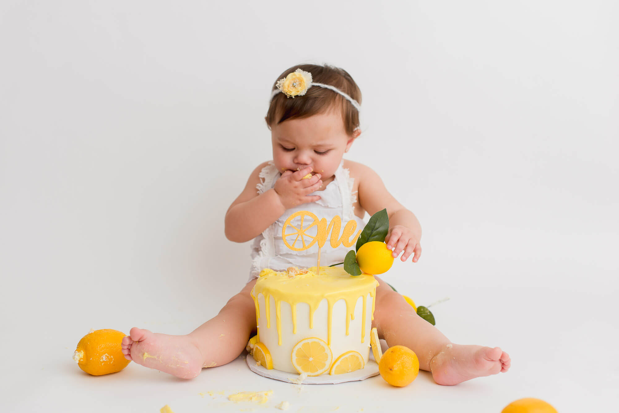 girl eats cake at lemon cake smash in Vancouver