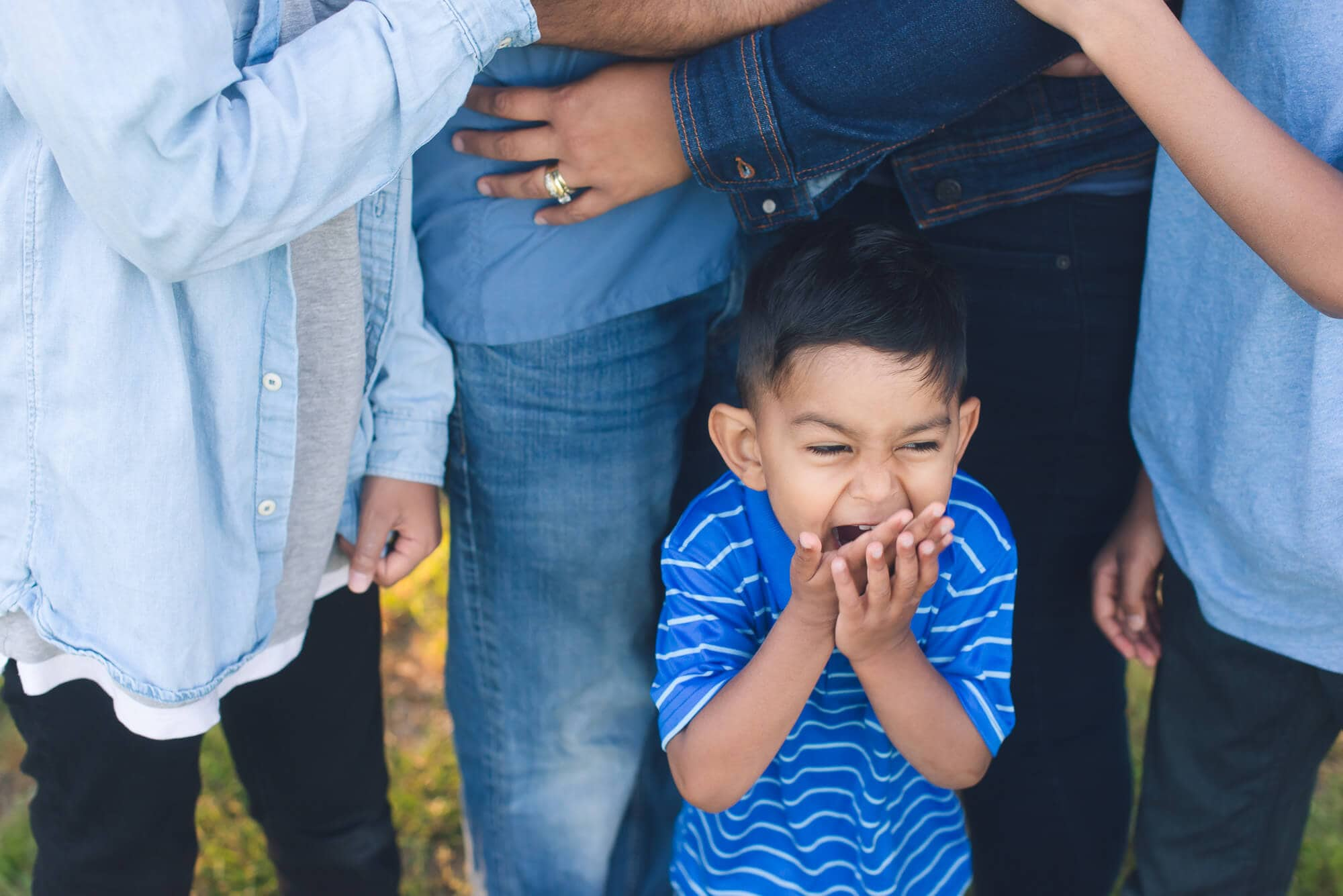 boy laughing at family session
