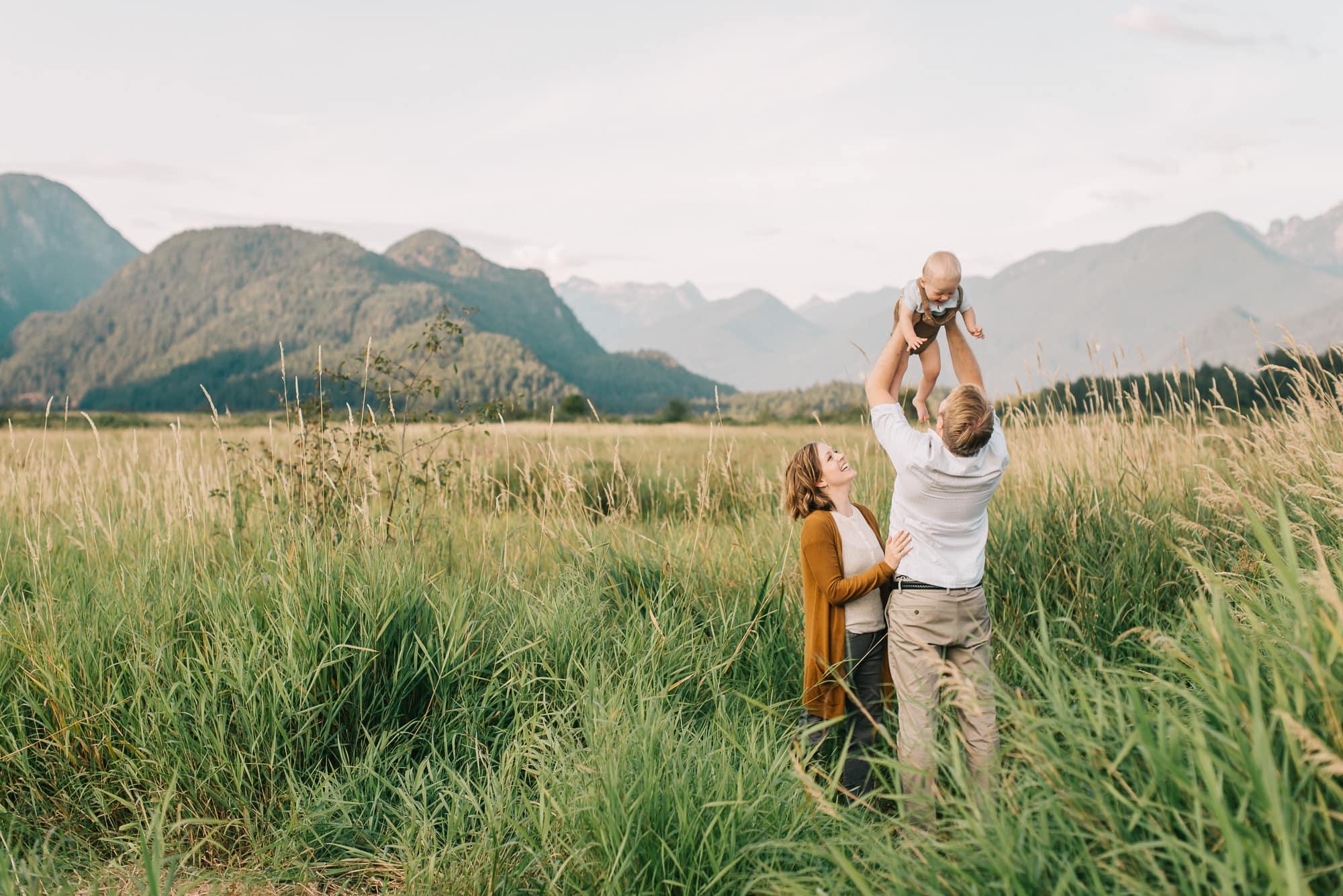 dad throwing boy in air at Pitt Lake photo session