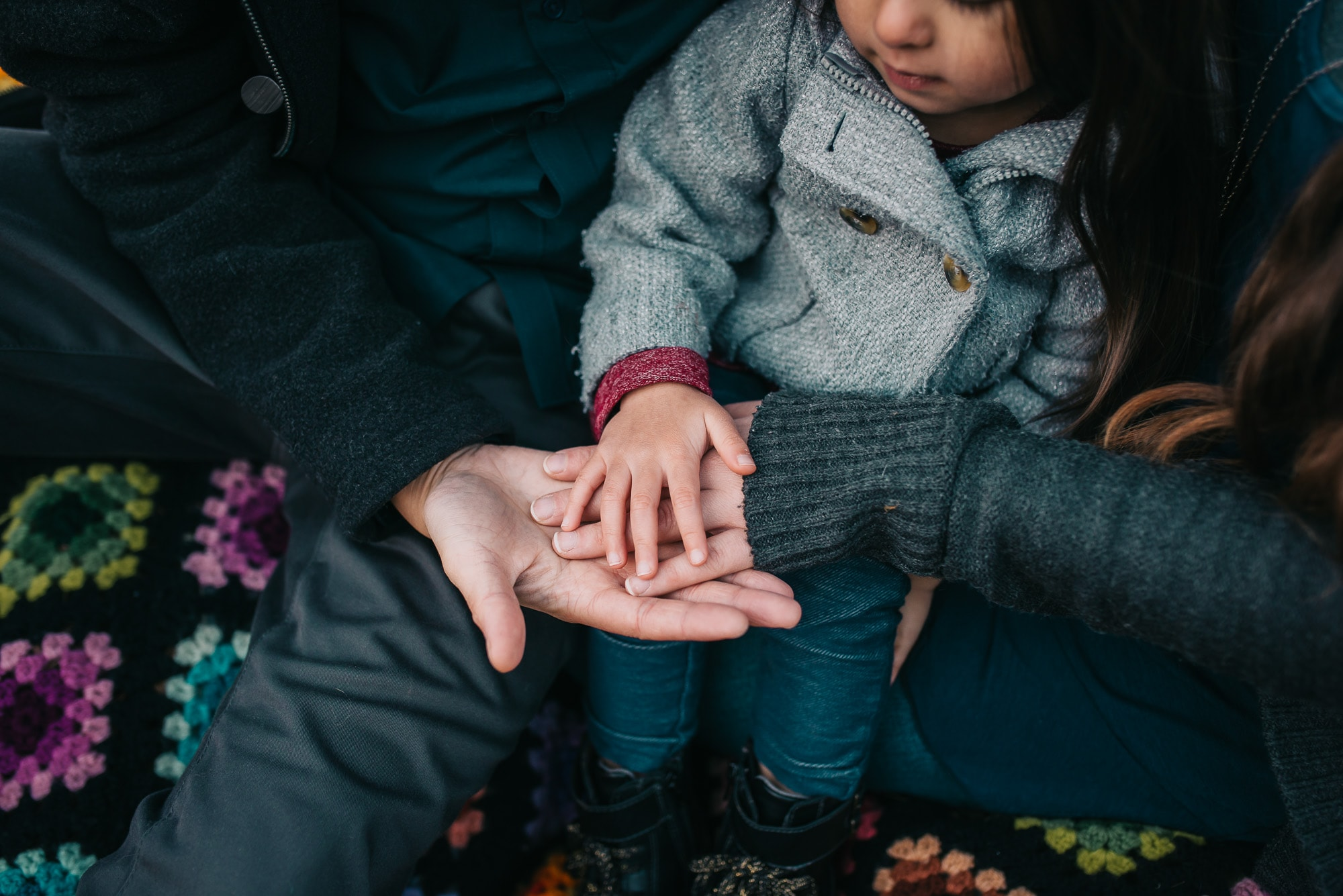 Vancouver Family Photographer asks family to put hands together in photo