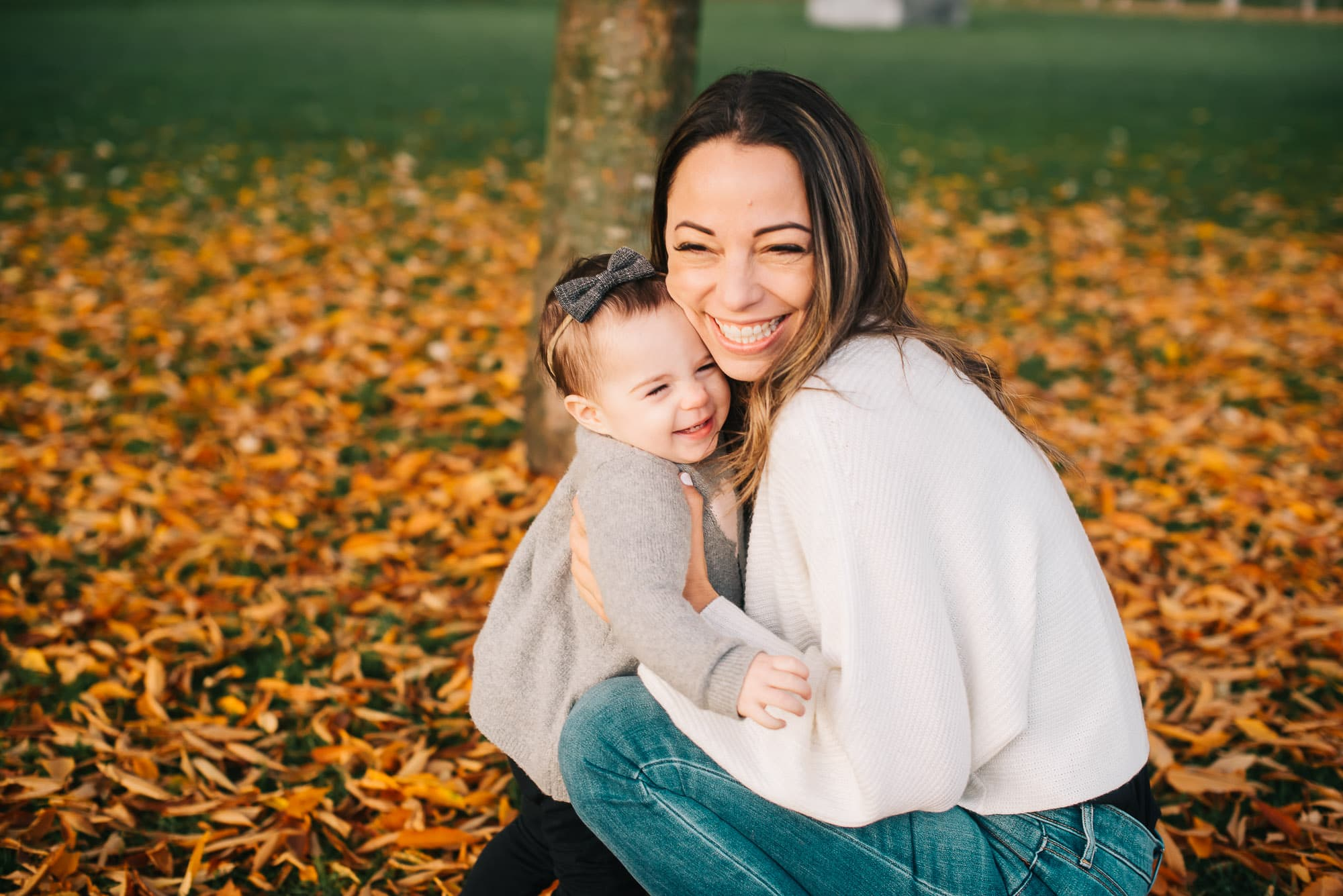 Vancouver Family Photographer captures mom and girl hugging in fall leaves