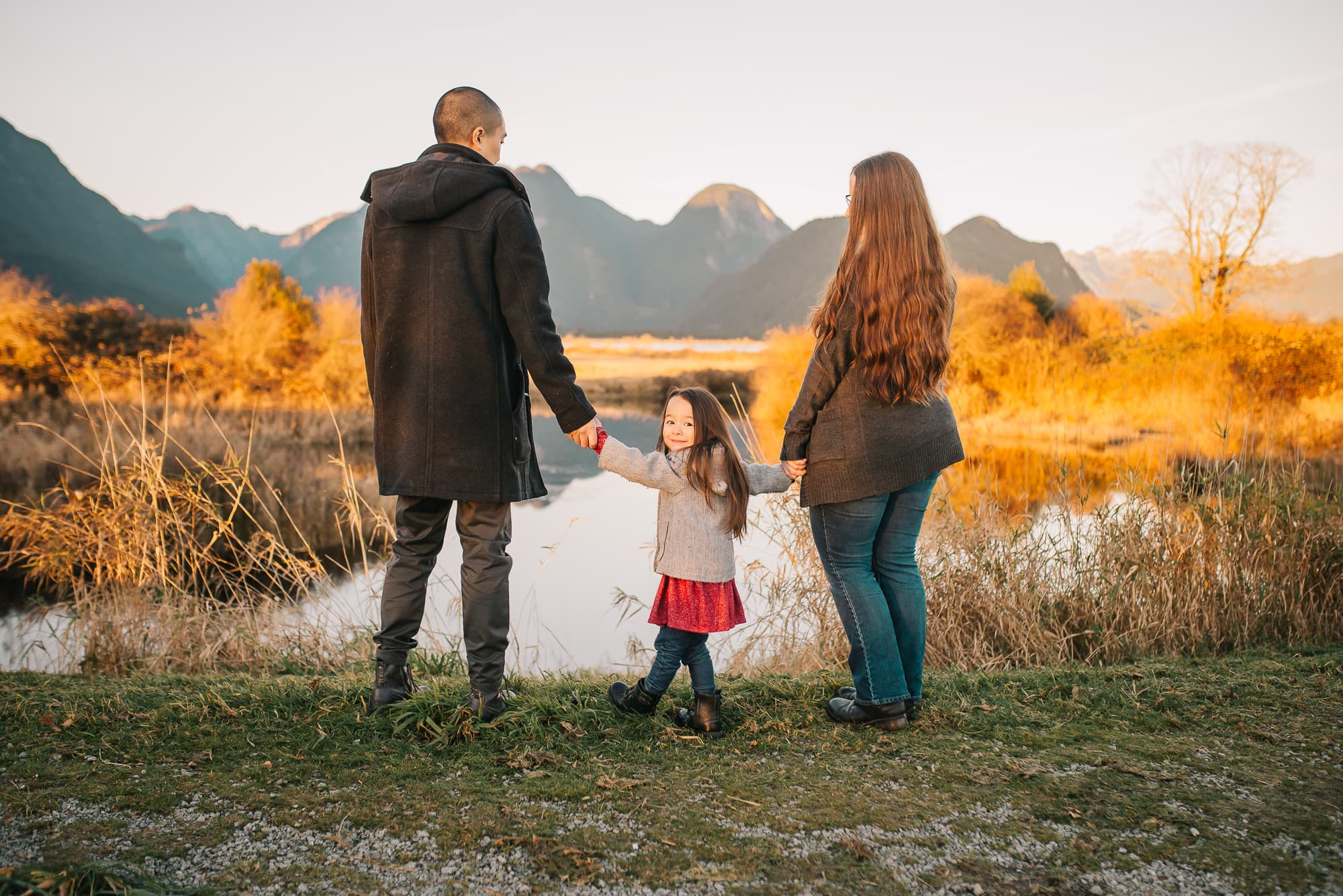 girl looks back at Vancouver Family Photographer during session at Pitt Lake