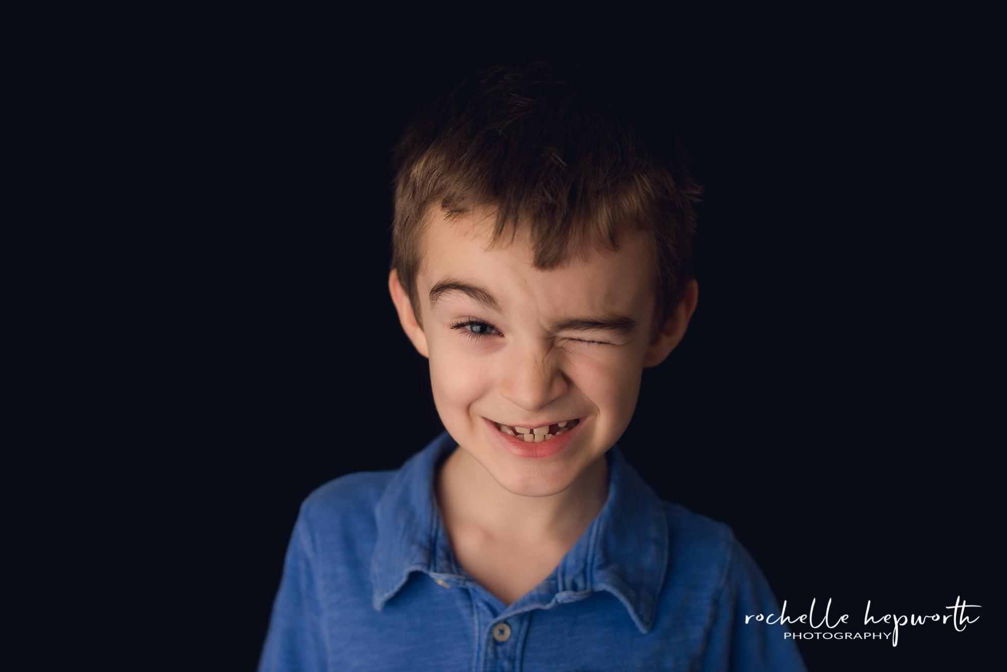 boy winking in fine art school portrait