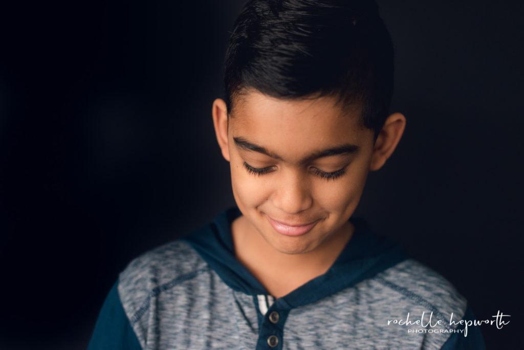 school photo of shy boy