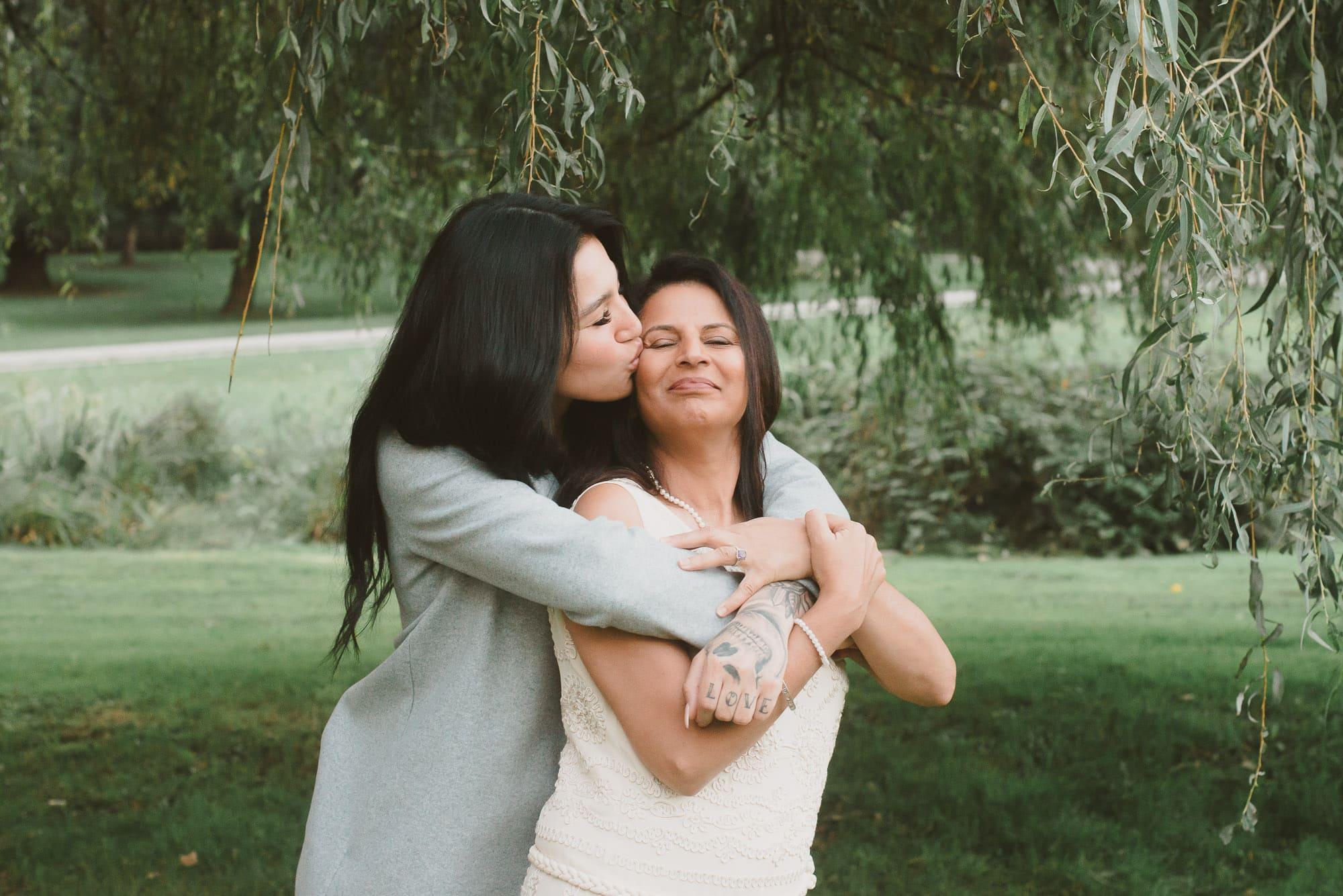 older daughter hugging mom