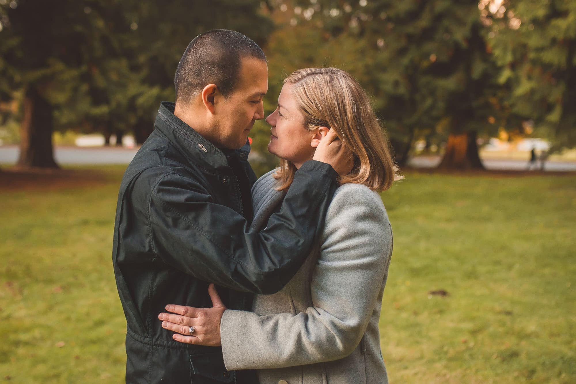 tender moment between mom and dad captured by Vancouver Family Photographer