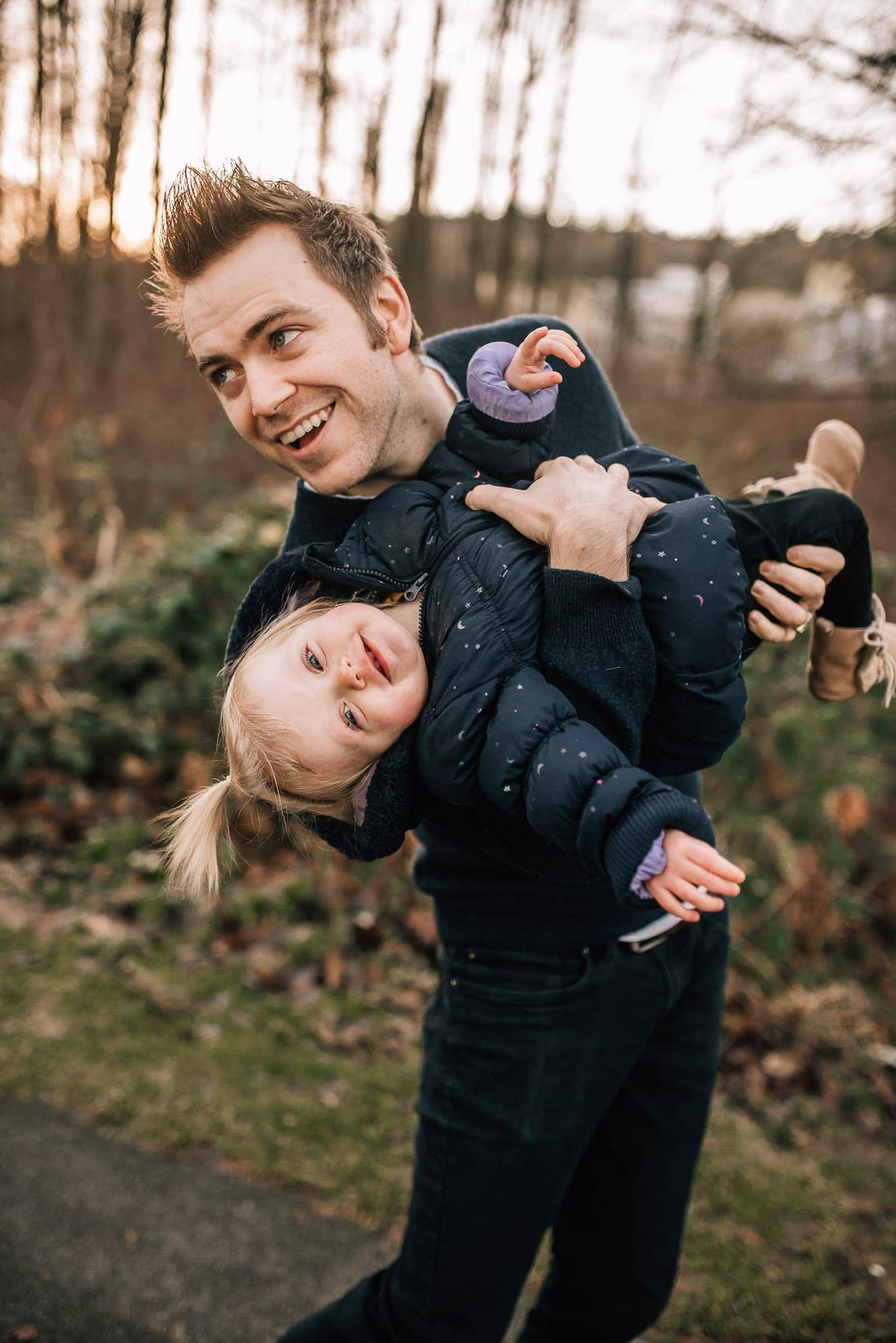 Vancouver Family Photographer captured dad dipping his daughter and laughing