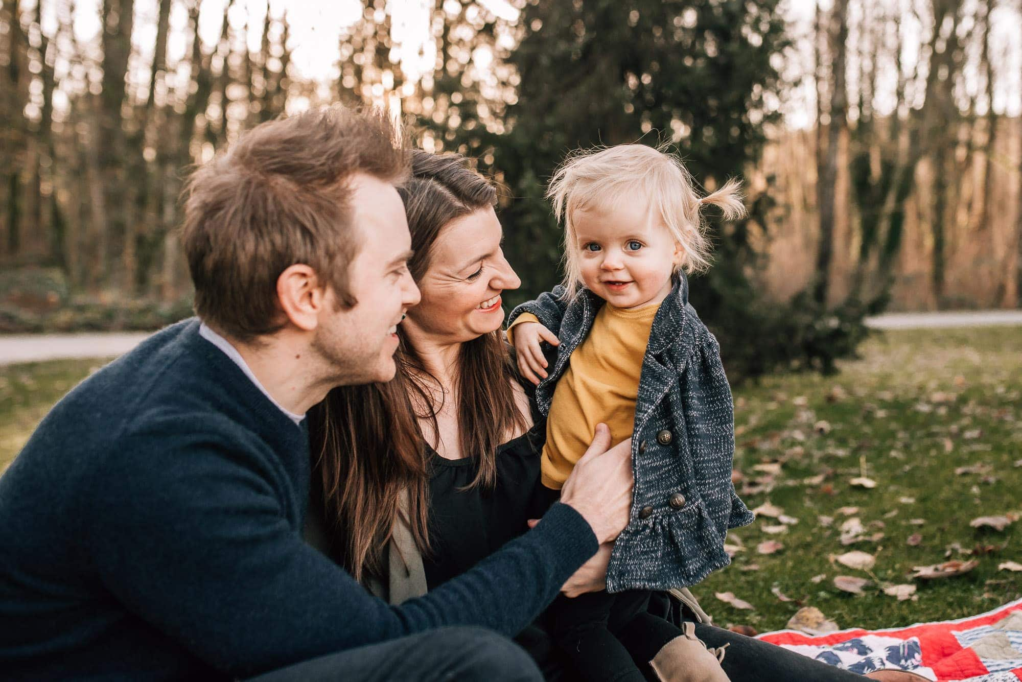 Couple hold daughter in Port Coquitlam session with Vancouver Family Photographer