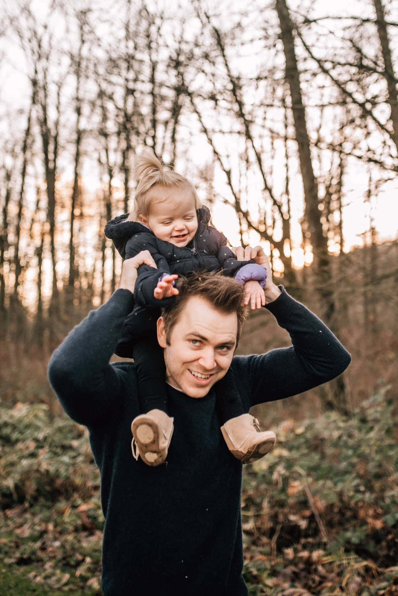 girl rides on dads neck during session with Vancouver Family Photographer