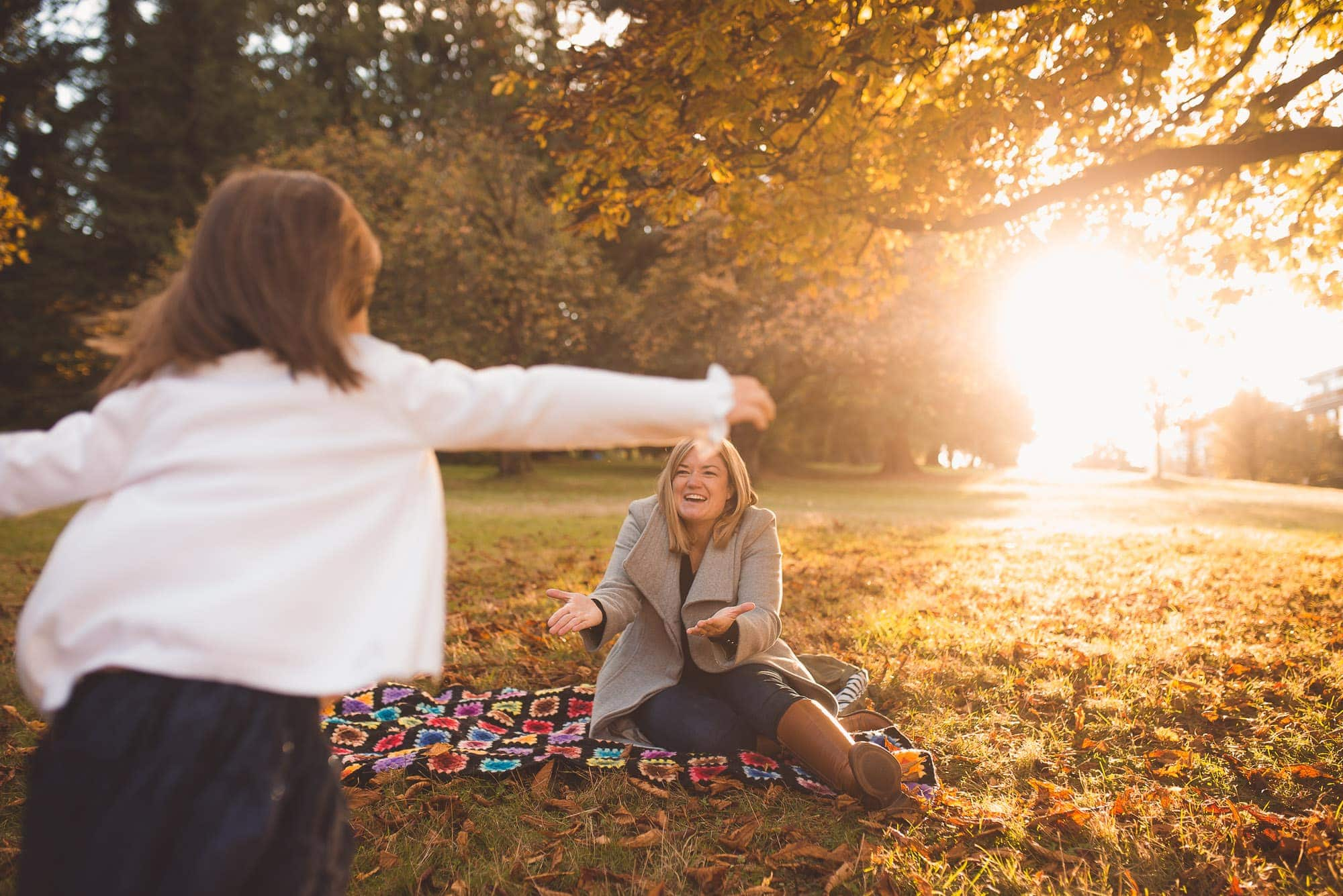 girl runs into moms arms at Vancouver sunset photo session