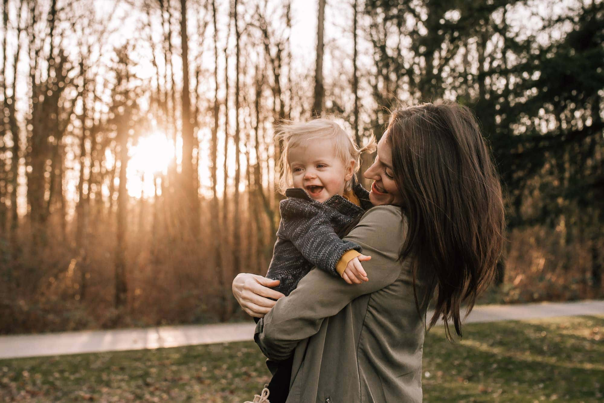 mom and baby laugh at sunset in Port Coquitlam photo session with Vancouver Family Photographer