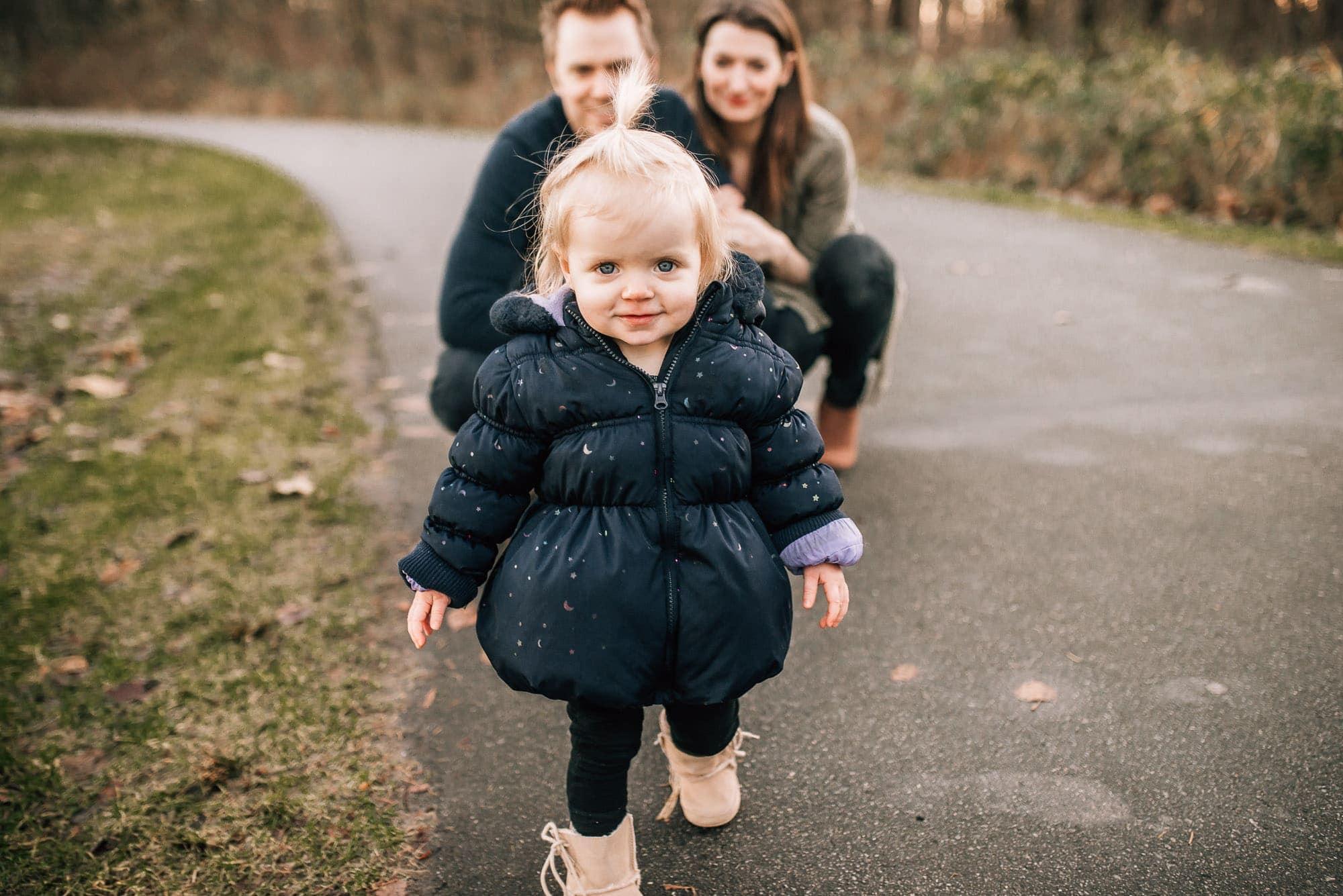 toddler girl walks towards Vancouver Family Photographer