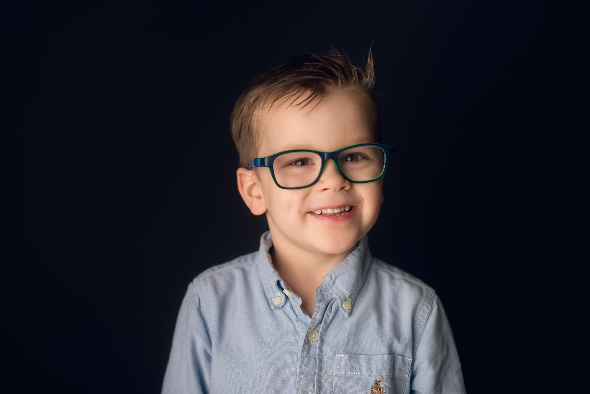 school portraits of child with glasses