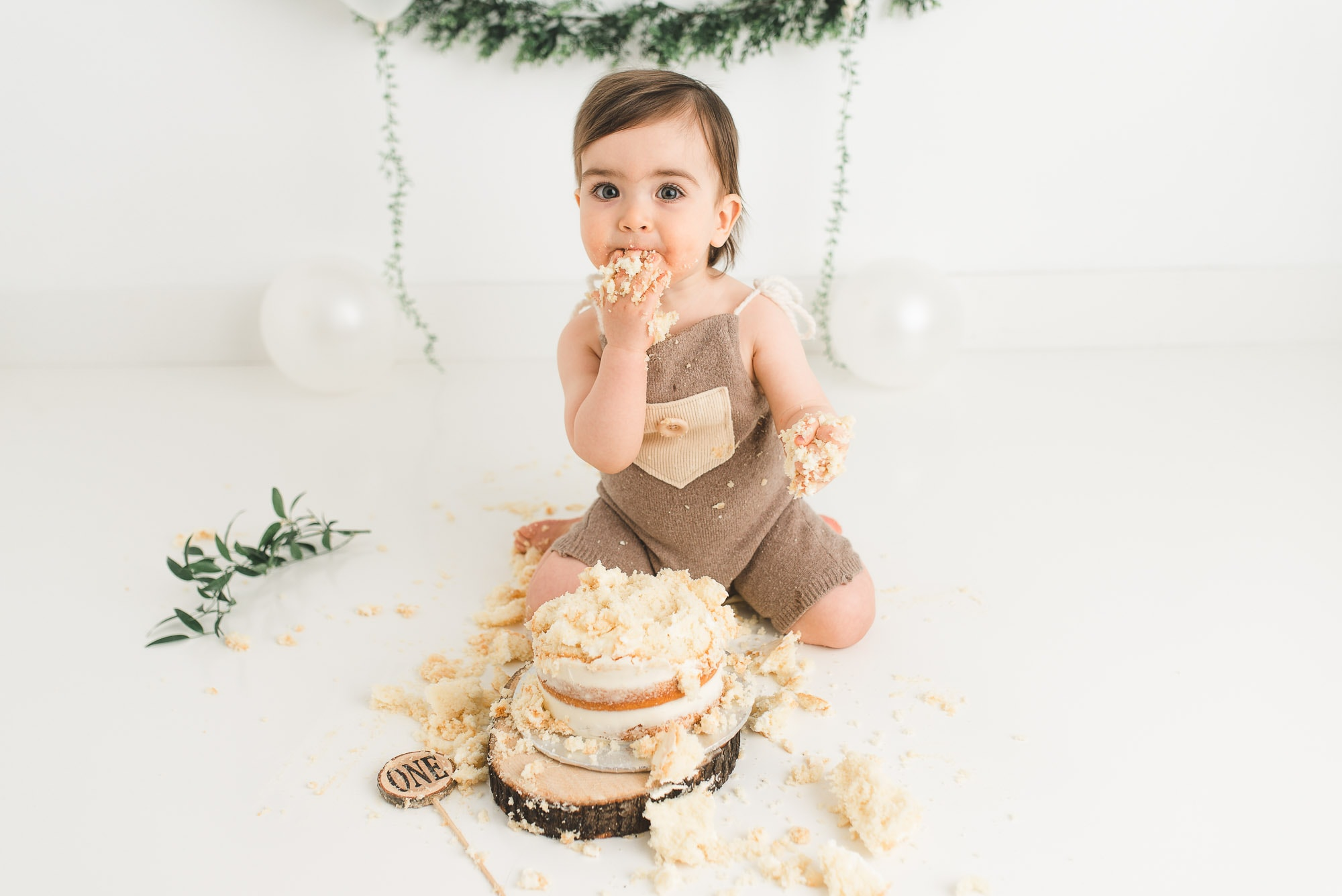 one year old eating smash cake in Coquitlam