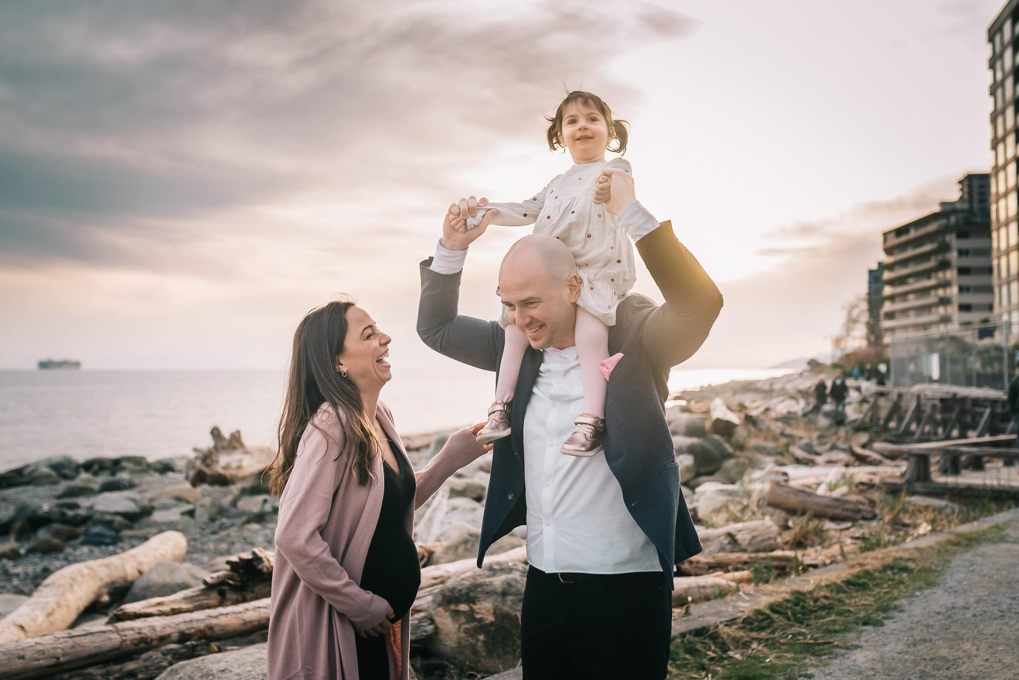 sunset family photos in Vancouver with girl on dad's neck