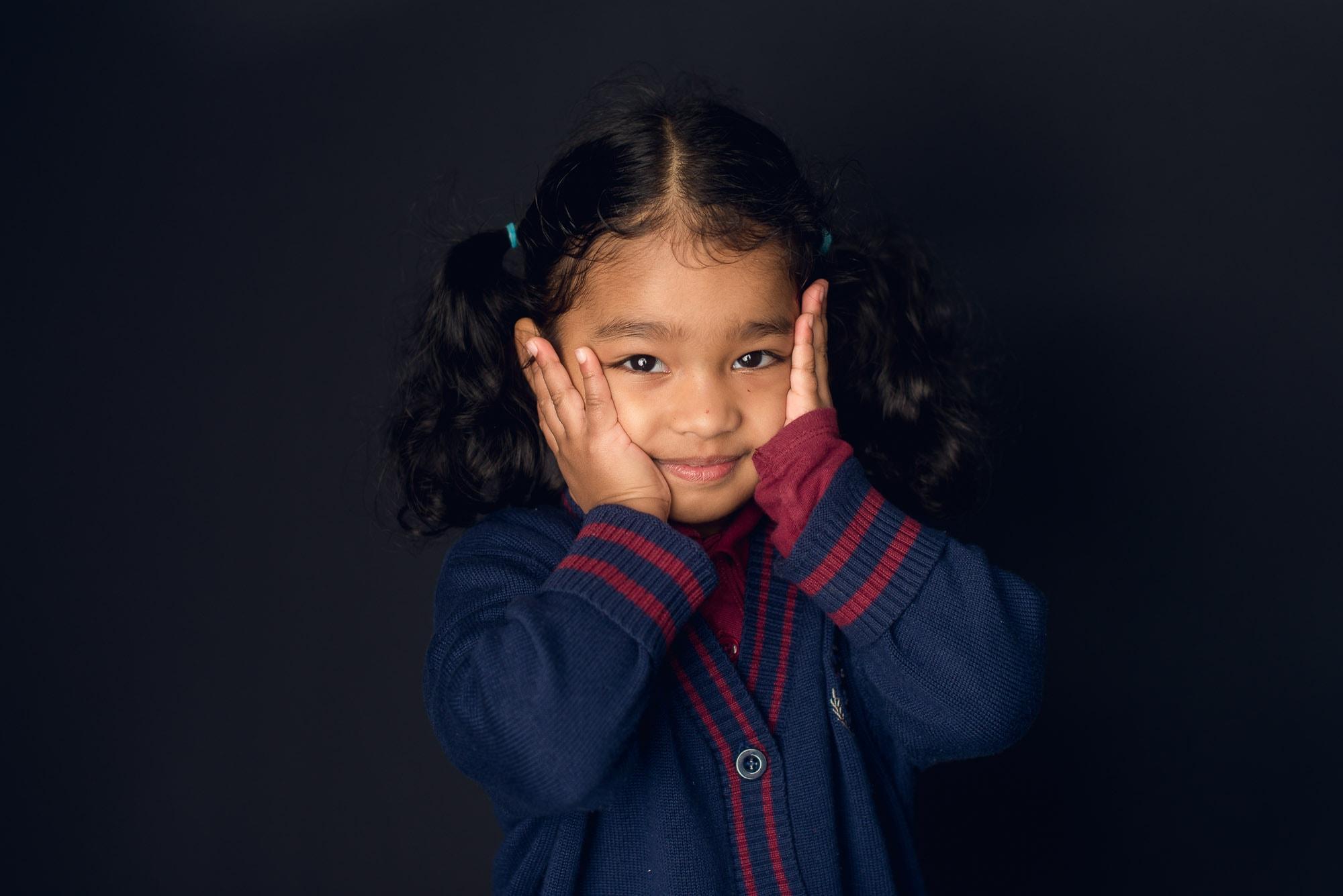 Cute girl smushing cheeks in Burnaby daycare photos