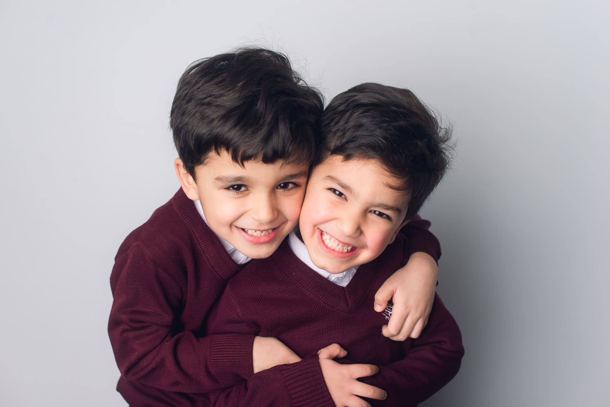 brothers hugging in Vancouver school photo